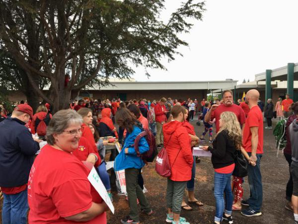 <p>School teachers and community members spilled into the courtyard at the Battle Ground Public Schools board meeting Monday night after the room filled to capacity.</p>