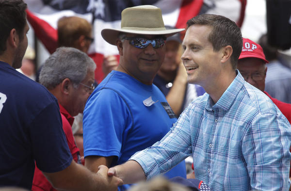 In this Aug. 14, 2014 photo, U.S. Rep. Rodney Davis shakes hands with people attending the Republican Day rally at the Illinois State Fair in Springfield. (Seth Perlman/AP)