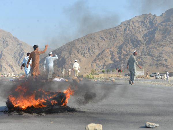 Men shout slogans against terrorists after a suicide attack among the protesters in Momandara district of Nangarhar province, Afghanistan, on Tuesday.