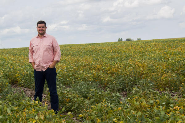 Scott Henry of Long View Farms in central Iowa stands amid soybeans in early September. After harvest this fall, the field will be seeded with a rye cover crop, which will keep the landscape green until spring planting season.