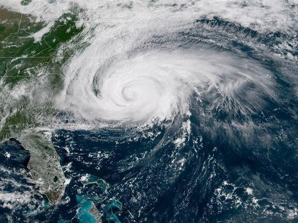 "Hurricane Florence will bring ""catastrophic flash flooding"" to the Carolinas, the National Hurricane Center says. Sustained hurricane-force winds are hitting North Carolina."