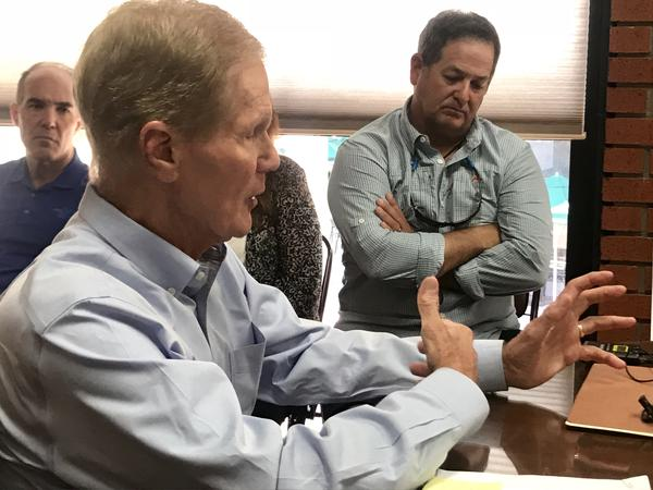 US Senator Bill Nelson talks with Sanibel business owners about impacts of algae on tourism and economy