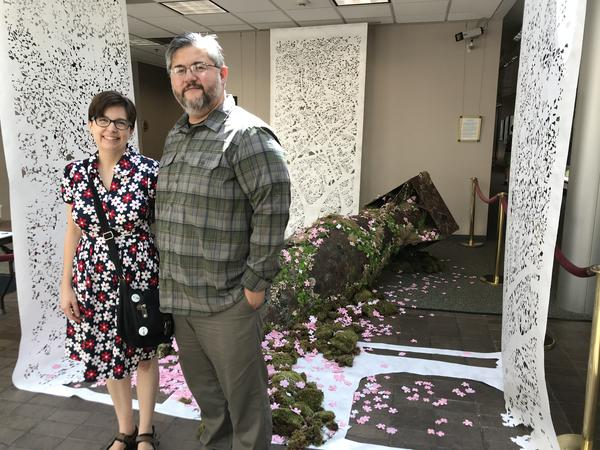 Sarah and Phong Nguyen in front of their exhibition 'Break into Blossom' at the Truman Library and Museum.