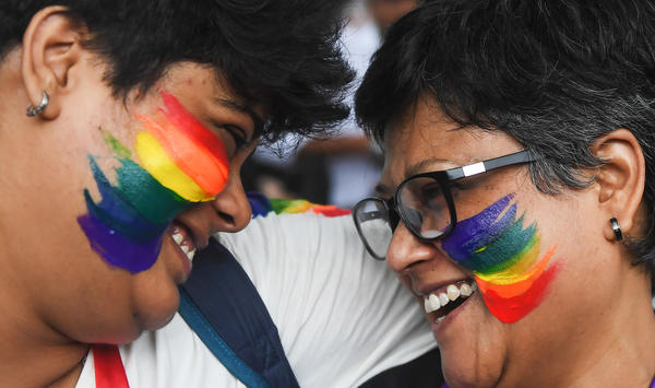 Indians in Kolkata celebrate the Supreme Court decision to strike down a colonial-era ban on gay sex.