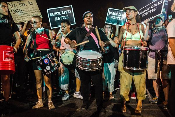 Protesters take to the streets of St. Louis with drums and Black Lives Matter signs during the protest against the Jason Stockley verdict.