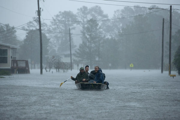 Volunteers from all over North Carolina help rescue residents from their flooded homes in New Bern, N.C., on Friday. Florence made landfall as a Category 1 hurricane and was eventually downgraded to at tropical storm.