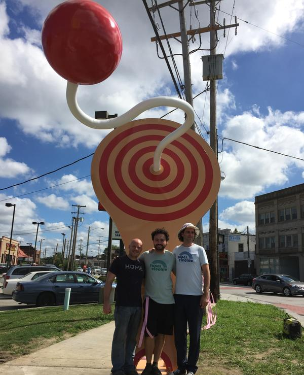 Dane Turpening of Toledo Twisted Iron (left) and David Spasic and Ben Haehn of Superelectric were part of the design team that helped make the 14-foot paddle ball a reality.