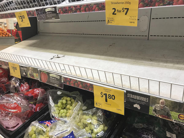 Empty shelves, normally stocked with strawberries, are seen at a Coles Supermarket in Brisbane, Australia.