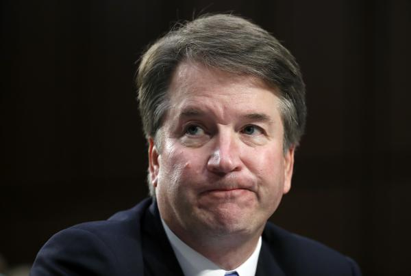 Supreme Court nominee Brett Kavanaugh reacts as he testifies Sept. 6 before the Senate Judiciary Committee on Capitol Hill in Washington.