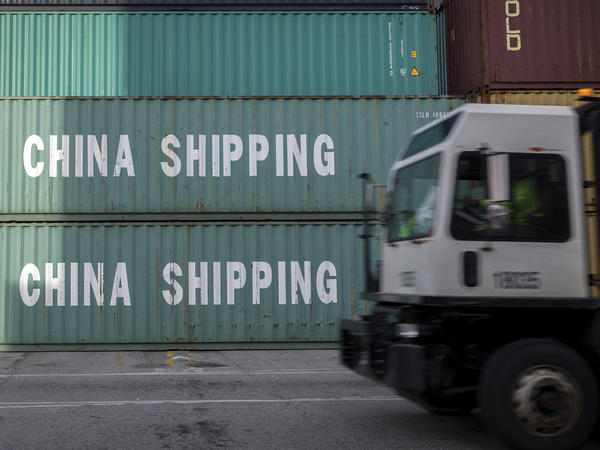 A truck passes a stack of Chinese shipping containers at the Port of Savannah in Georgia in July.