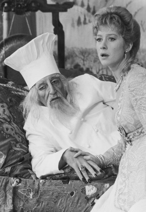 British actor Peter Sellers stars with actress Helen Mirren in <em>The Fiendish Plot of Dr. Fu Manchu </em>in 1980. Sellers is wearing a chef's hat in the role of Dr. Fu Manchu, while Mirren plays the role of Alice Rage.