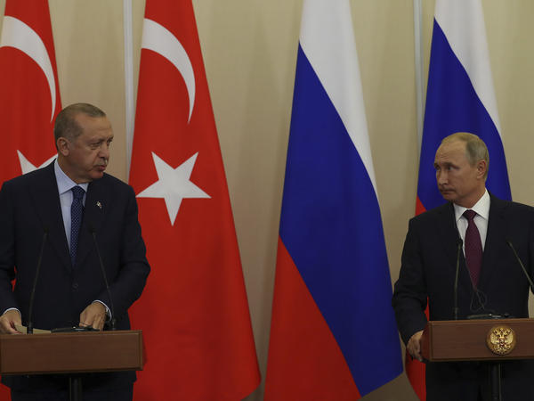 Russian President Vladimir Putin (right) listens to Turkey's President Recep Tayyip Erdogan, during a joint news conference following their meeting in Sochi, Russia, Monday. The province of Idlib in northwestern Syria is the largest bastion of the opposition, and Turkey has been eager to prevent a potential government offensive there.