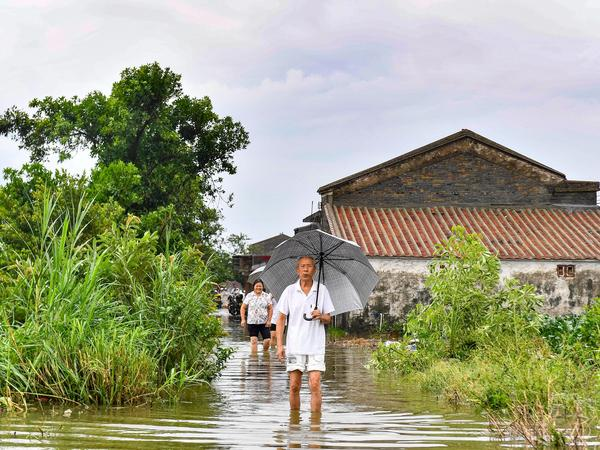 A man wades through flood water in Jiangmen, in China's Guangdong province on Monday.