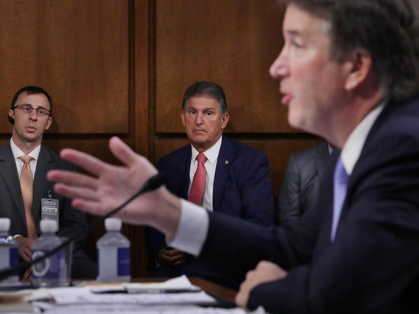 Sen. Joe Manchin, D-W.Va., listens to Supreme Court nominee Judge Brett Kavanaugh as he testifies before the Senate Judiciary Committee on Sept. 6. Running a tight re-election race in a conservative state, Manchin has faced pressure to support Kavanaugh.