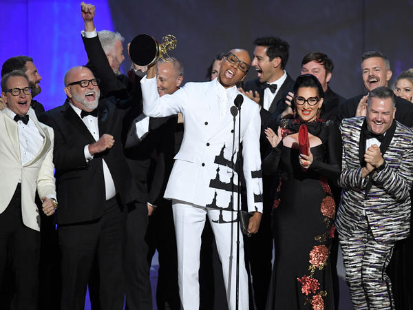 RuPaul and cast and crew accept the award for outstanding reality-competition program for 'RuPaul's Drag Race' during the 70th Emmy Awards.