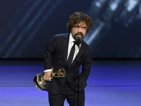 Peter Dinklage accepts the award for outstanding supporting actor in a drama for 'Game of Thrones' at the 70th Emmy Awards.
