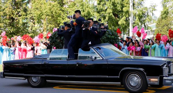 Photographers and cameramen from North Korean media document the motorcade of South Korean President Moon Jae-in and North Korean leader Kim Jong Un as it travels through Pyongyang, North Korea.