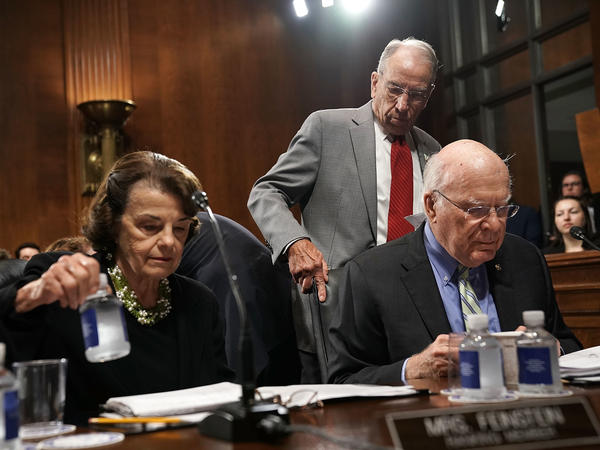 Democratic Sens. Dianne Feinstein and Patrick Leahy (seated) with Judiciary Committee Chairman Chuck Grassley.