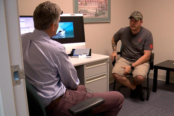 Former Marine Josh Onan talks with George Kevin Flood, a staff psychiatrist at the San Diego VA. Onan is taking advantage of a year-old program that makes VA care available to people with less-than-honorable military discharges.