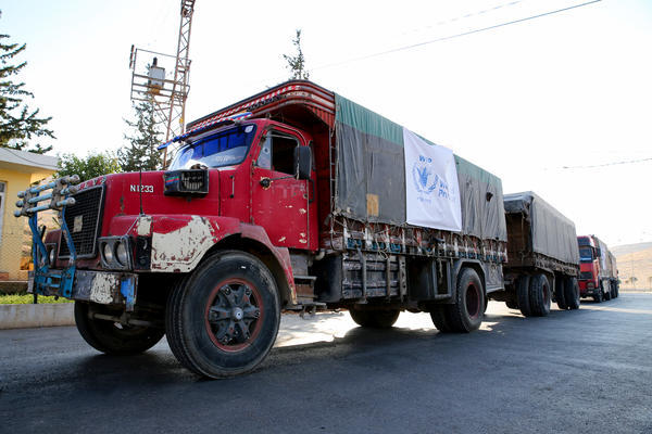 A World Food Programme convoy carries humanitarian aid to Aleppo, Syria. Getting food into conflict zones is a major hurdle — and a topic of discussion at the WFP's Innovation Accelerator.