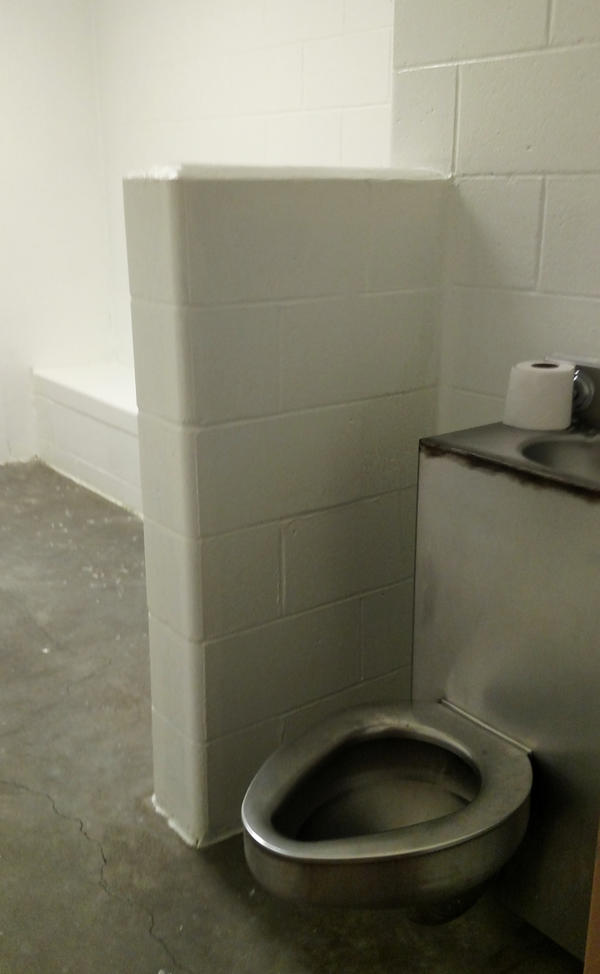 A cell in the Champaign County Jail that's sometimes used to house inmates who are suicidal. For the inmates' own safety, jail officials say, they may be placed alone in the cell with nothing but a mat and a garment that cannot be used to cause self-harm.