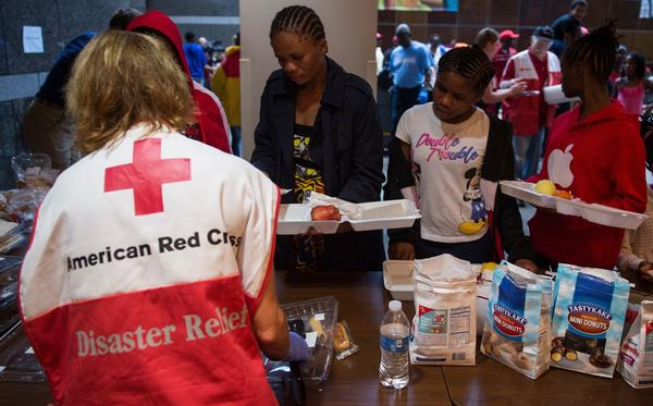 People wait for food inside an American Red Cross evacuation shelter in Chapel Hill, N.C., on Monday.