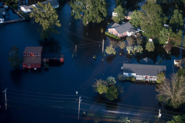 Homes in Conway, S.C., are surrounded by floodwaters from Hurricane Florence on Monday. Many rivers in the Carolinas are approaching record flood stages and their levels will continue to rise through the week.