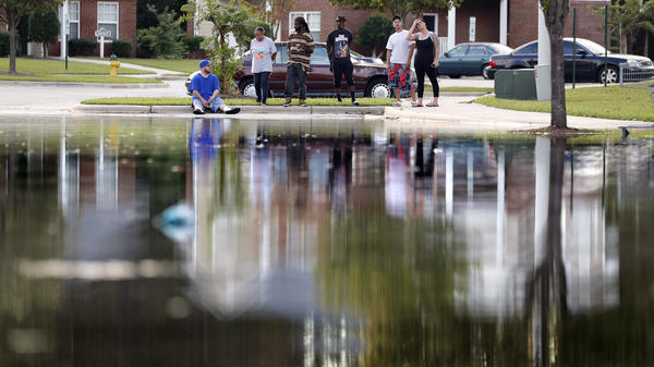 Residents look out at the flooded entrance to an apartment complex near the Cape Fear River in Fayetteville, N.C., earlier this week.