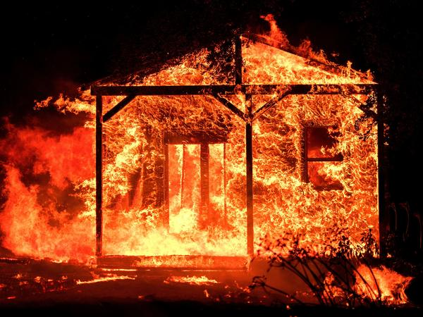 Flames consume an evacuated home in the Napa Valley wine region last October. California's Department of Insurance says the total insurance claims in 2017 were the highest on record — including nearly $12 billion over the final three months of the year.