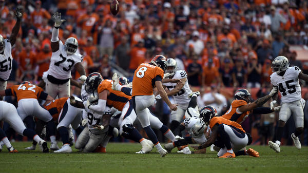 Kicker Brandon McManus (8) of the Denver Broncos kicks the game-winning field goal during the fourth quarter on Sunday at Broncos Stadium.