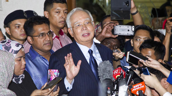 Former Prime Minister Najib Razak speaks during a press conference after being granted bail at a court hearing at Kuala Lumpur High Court in Kuala Lumpur, Malaysia, Thursday. Najib pleaded not guilty Thursday to 25 fresh charges of abuse of power and money laundering over the multimillion-dollar looting of a state investment fund.