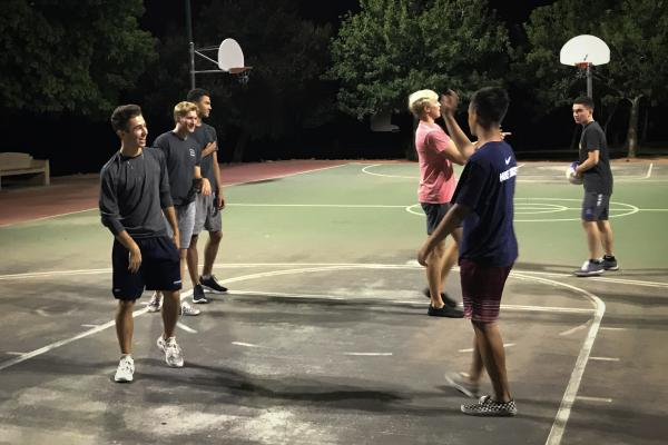 Nick Campbell plays basketball with his friends.