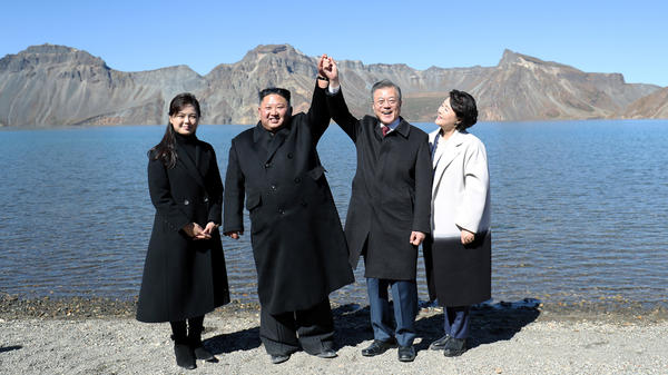 South Korean President Moon Jae-in, first lady Kim Jung-sook, North Korean leader Kim Jong Un and his wife Ri Sol Ju pose for beside the Heaven Lake of Mount Paektu, North Korea, Sept. 20.