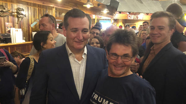 Republican U.S. Sen. Ted Cruz (left) poses with Gary Malcik following a campaign stop in Temple, Texas, last month.