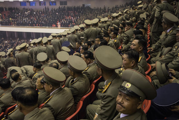 North Korean military prepare to exit a concert hall at the end of an orchestral performance to mark the 70th anniversary of the founding of the nation.