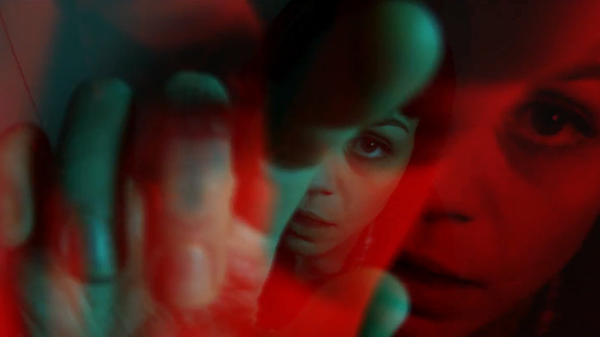 """A still from 180dB's """"Road Trip"""" video, featuring Meredith Graves and Nick Zinner."""