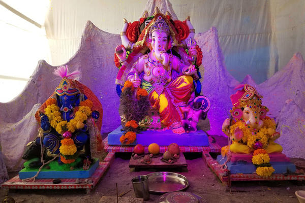Neighborhoods get together to erect temporary stages called <em>pandals</em>, on which they place giant Ganesh statues, and hold block parties around them.