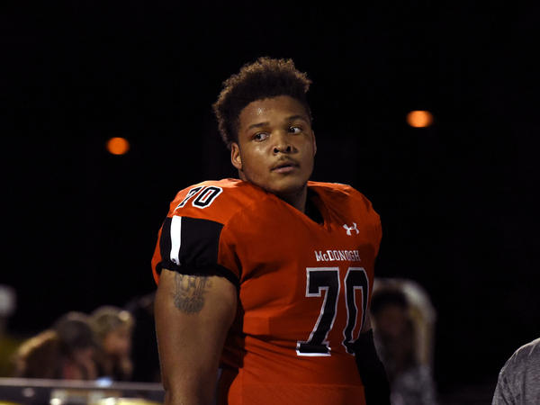 Jordan McNair, seen playing high school football in 2016, died on June 13, 2018, two weeks after collapsing during a University of Maryland team workout.