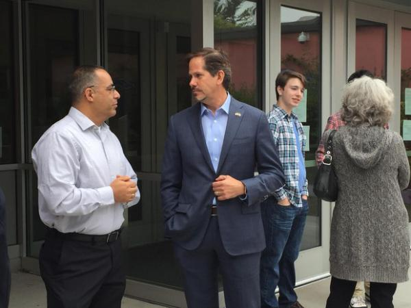 <p>Republican gubernatorial candidate Knute Buehler (center, blue suit) speaks with supporters and students outside Davis Elementary School in Gresham on June 28, 2018.</p>