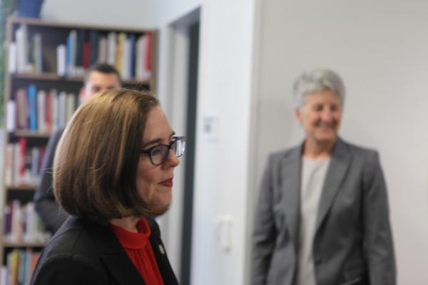 <p>Oregon Gov. Kate Brown (left, foreground) was among the state and local officials on hand to tour Oregon State University-Cascades and celebrate funding for a new building, in April 2018. She was joined by vice president Becky Johnson (right, background).</p>