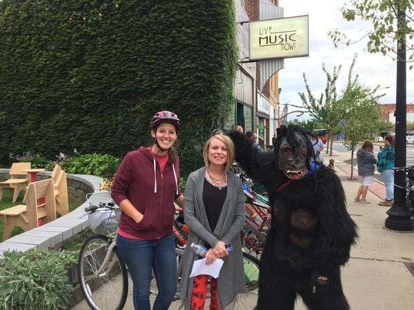 Tina Boyes (center), director of the Kenmore Neighborhood Alliance, put together 'Boulevard Bikes + Brews' to showcase the the bikability of the area, and it included a ride led by Marissa Little and 'Kenmore Grass Man' Greg Milo.