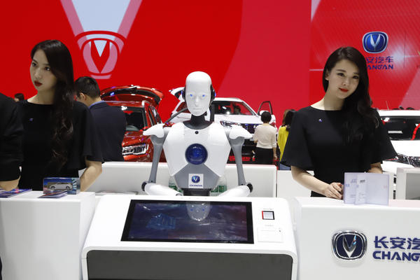 "FILE - In this April 26, 2018, file photo, a robot assist receptionist is seen at the booth of a Chinese automaker during the China Auto 2018 show in Beijing, China. Under President Xi Jinping, a program known as ""Made in China 2025"" aims to make China a tech superpower by advancing development of industries that in addition to semiconductors includes artificial intelligence, pharmaceuticals and electric vehicles. (AP Photo/Ng Han Guan, File)"