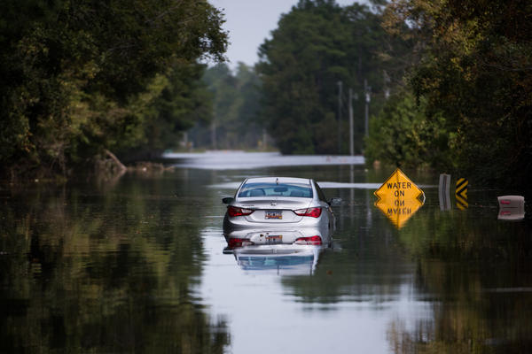 A disabled car is surrounded by floodwaters from Hurricane Florence near the Todd Swamp in Longs, S.C., last week.