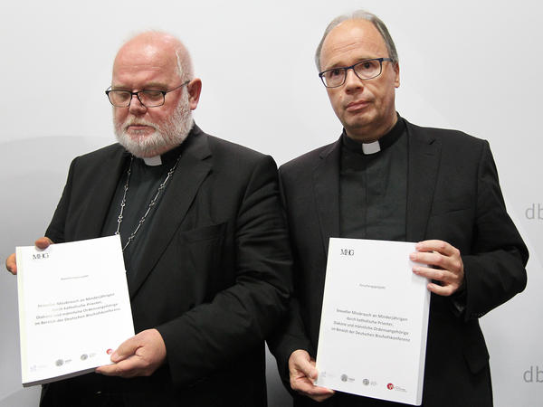 Cardinal Reinhard Marx and Bishop Stephan Ackermann present the results of the study on sexual abuse of minors by Germany's Catholic priests and clerics on Tuesday in Fulda, Germany.