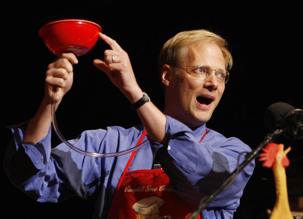 """Brian Wansink demonstrates his """"bottomless bowl of soup"""" — used to show that people eat more when served in a bowl secretly replenished from the inside — after he was awarded a 2007 Ig Nobel Prize in 2007 at Harvard University. Wansink made a name for himself producing pithy, palatable studies that connected people's eating habits with cues from their environment."""