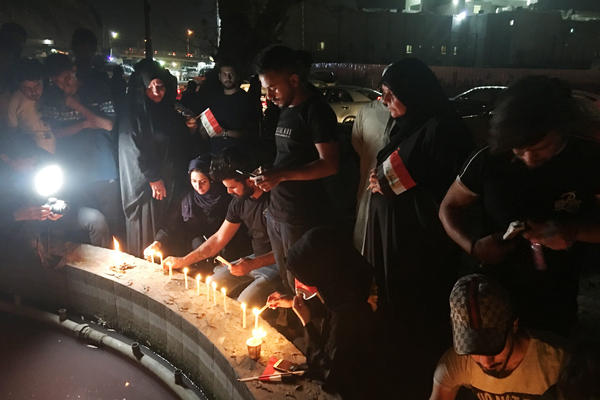 Protesters light candles in commemoration of young men killed by security forces in anti-government demonstrations in Basra in early September.