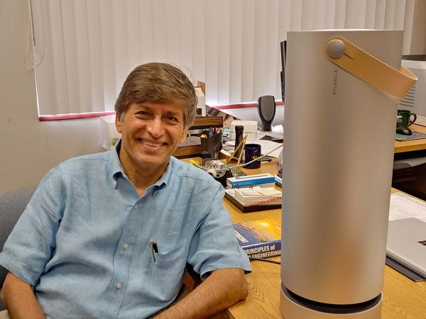 Professor Yogi Goswami and his invention, the Molekule air purifier.