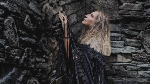 Barbra Streisand on the cover <em>Walls</em>.