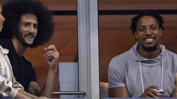 Eric Reid (right) has signed a one-year contract with the Carolina Panthers. He is seen here last month, watching the U.S. Open tennis tournament with former San Francisco 49ers teammate Colin Kaepernick.