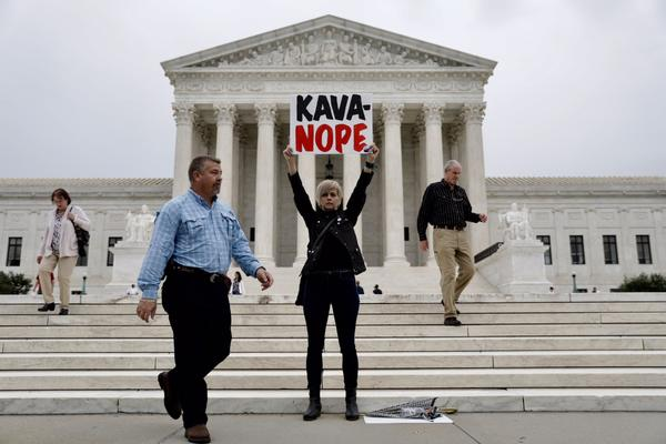 Outside the Supreme Court, people gathered Thursday morning to protest Kavanaugh's nomination.